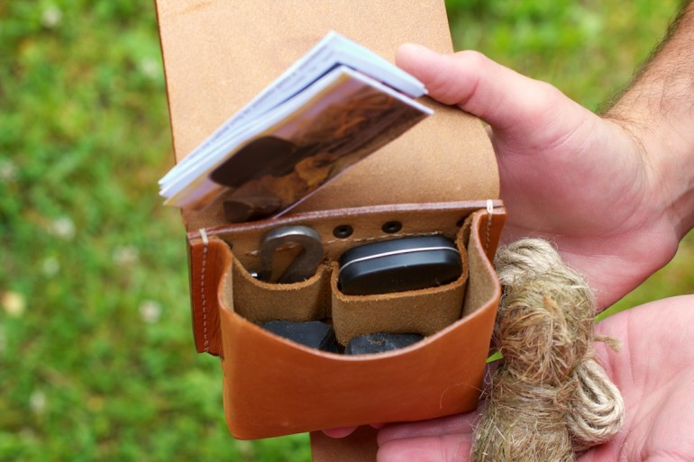 Leather pouch with compartments for firesteel, tinder box and flint