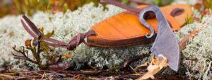 forged flint striker in leather sheath
